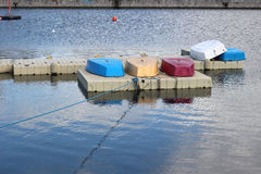 Small colored boats and returned on the dock of a sailing school before the opening Royalty Free Stock Images