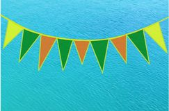 Small colored flags over blue sea background Stock Images