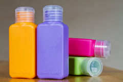 Small colored plastic bottles Royalty Free Stock Images