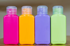 Small colored plastic bottles Stock Image