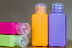 Small colored plastic bottles for traveling Royalty Free Stock Images
