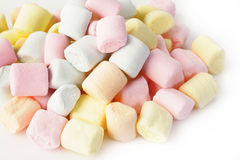 Small colored puffy marshmallows isolated on white Stock Photos