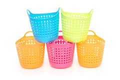 Small and colorful baskets stack up on white background Stock Image