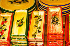Small colorful ceramic plates for olives Stock Images