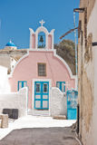 Small colorful church at Oia village, Santorini island Stock Image