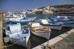 Small colorful fishing boats in the port. The harbor of Elunda in Crete, Greece stock photos