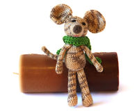 Small colorful knited Bright children's toy mouse model in a gre Stock Photos