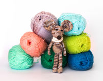 Small colorful knitted toy mouse in a white scarf Royalty Free Stock Photos
