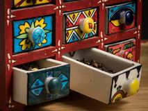 Small painted box with drawers for spices, open drawers stock images