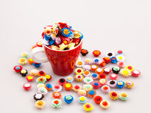Small, colorful paper flowers in a cup of coffee Stock Photo