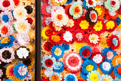 Small, colorful paper flowers Stock Images