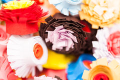 Small, colorful paper flowers Stock Photo