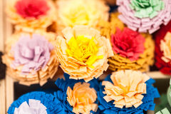 Small, colorful paper flowers Royalty Free Stock Photos