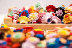 Small, colorful paper flowers Royalty Free Stock Image