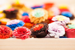 Small, colorful paper flowers Stock Image