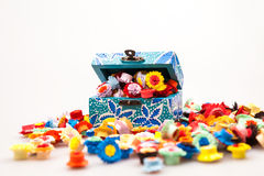 Small, colorful paper flowers and painted box Stock Photo