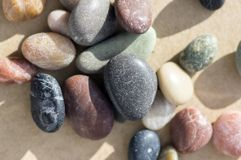 Small colorful pebbles background, simplicity, daylight, stones, white, green, grey, red, orange, Stock Photo