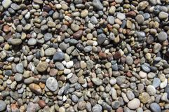 Small colorful pebbles background, tiny beach stones, various colors Royalty Free Stock Photography