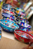 Small colorful pottery bowls in a row. Small beautiful arabic colorful pottery bowls arranged in a row at the street market of Antalya, Turkey Stock Photos