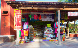 Small colorful souvenir shop located on the pier. Tourists can buy various souvenirs as a memory about beautiful Tropical Island. Royalty Free Stock Photos