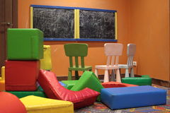Small and colorful table and chairs for little kids. In room stock image