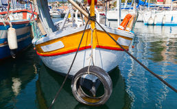 Small colorful wooden fishing boat, Corsica. Small colorful wooden fishing boat moored in Propriano town, Corsica, France Stock Photography