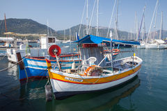 Small colorful wooden fishing boats, Corsica. Propriano, France - July 3, 2015: Small colorful wooden fishing boats moored in Propriano resort town, Corsica Royalty Free Stock Images