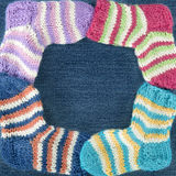 Small colorful woolen socks Royalty Free Stock Images