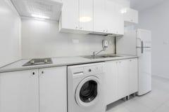 Small and compact kitchen interior design. White, small and compact kitchen interior design Stock Photo