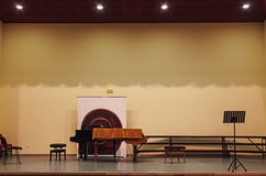 Small Concert Hall. Details of an empty small concert hall with stage piano and some chairs on it Royalty Free Stock Photography