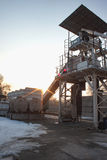 Small concrete batching plant. With silo at sunrise royalty free stock photography