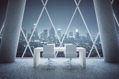 Small conference table in interior. Small wooden conference table in abstract office room interior with concrete columns and patterned withdow with night city Royalty Free Stock Photography
