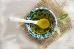 Small container with extra virgin olive oil Royalty Free Stock Images