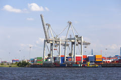 Small Container Terminal in Hamburg, Germany. Small container harbor with tall cranes in Hamburg Harbor, Germany Royalty Free Stock Photo