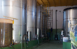 Small contemporary  winery factory with  stell barrels Royalty Free Stock Photos