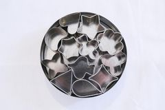 Small cookie cutters, kitchen items. Small cookie cutters, white background,top view, kitchen items stock image
