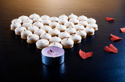 Small cookies laid in the shape of heart with red paper hearts o Stock Photography
