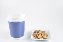 Small cookies on plate with take home paper coffee cup Stock Photography
