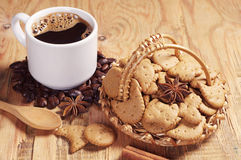 Small cookies in wicker basket and coffee Stock Photography