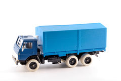 A small copy a blue onboard trucks. A small copy blue flatbed truck on white background made of metal Stock Image