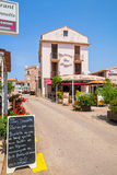 Small Corsican town street view with pizzeria facade Royalty Free Stock Photography