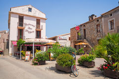 Small Corsican town street view with pizzeria Stock Photos