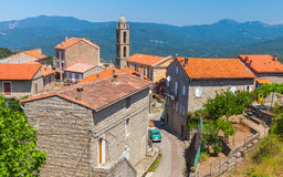 Small Corsican village landscape with mountains Stock Photo