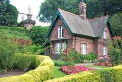 Small cottage. Surrounded by a beautiful garden Stock Images