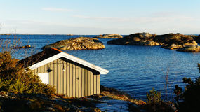 Small cottage fishing near  fjord Stock Images