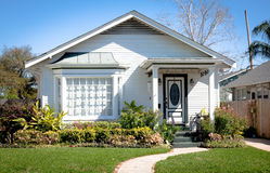 Small Cottage Home. Cute American cottage style home with white trim Stock Image