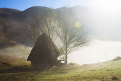 Small cottage in the mountains-panoramic view Royalty Free Stock Photography
