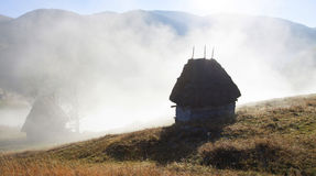 Small cottage in the mountains-panoramic view Royalty Free Stock Photos