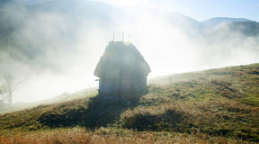Small cottage in the mountains-panoramic view Royalty Free Stock Image