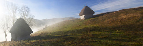 Small cottage in the mountains-panoramic view Stock Photography